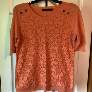 Orange short sleeve sweater with lace on front